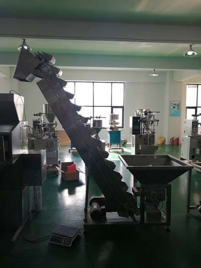 hoist conveyor for fish powder packing